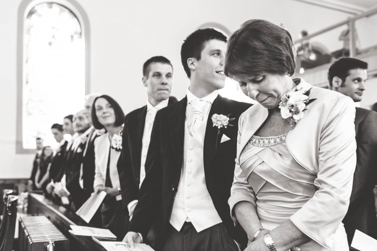 Mother of the bride becomes emotional as the bride walks up aisle