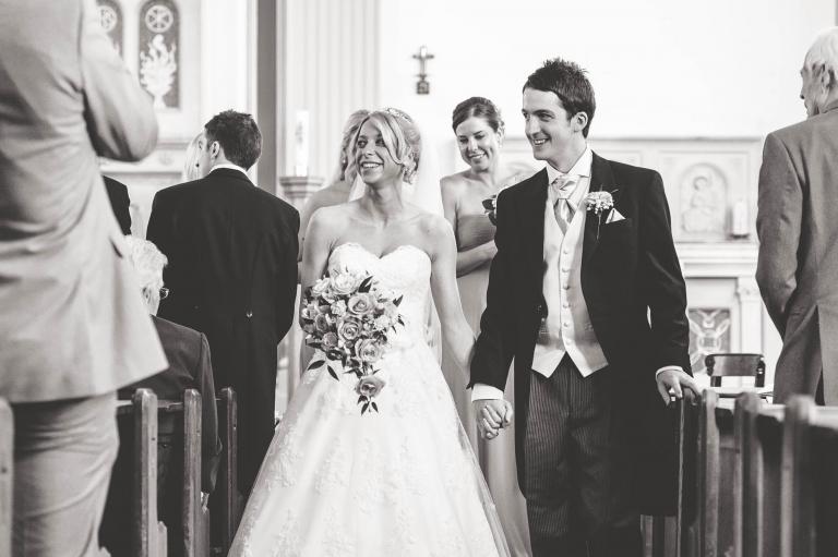 The newlyweds walk back down the aisle