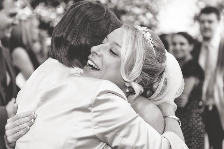 Bride and her mum hug