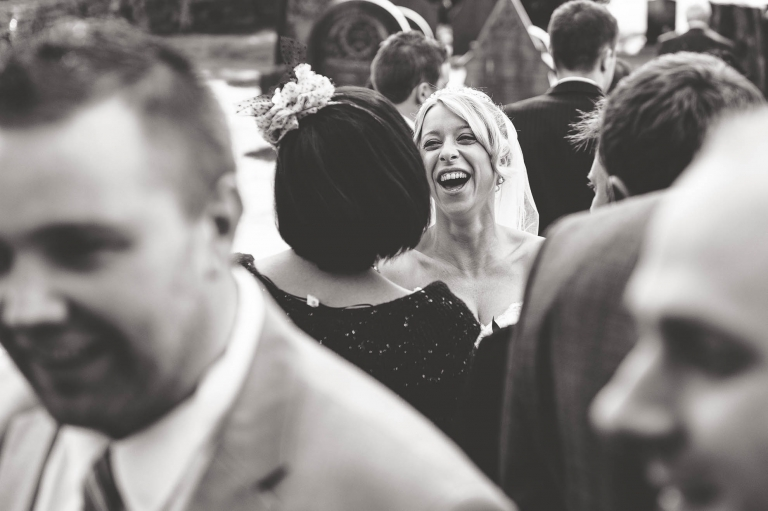 Bride shares a joke with a guest