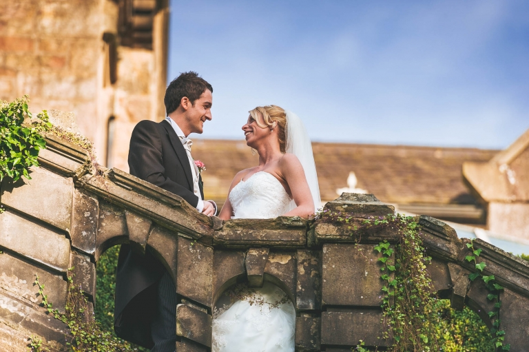 Portrait of bride and groom on steps