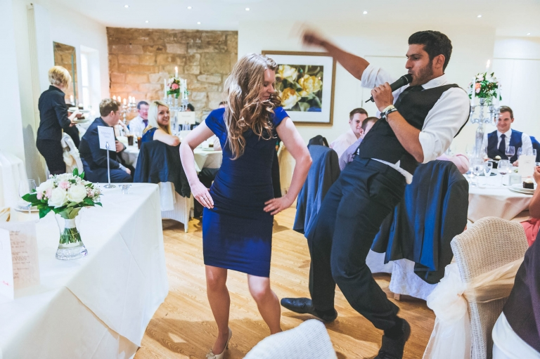 Guest dances with singing waiter
