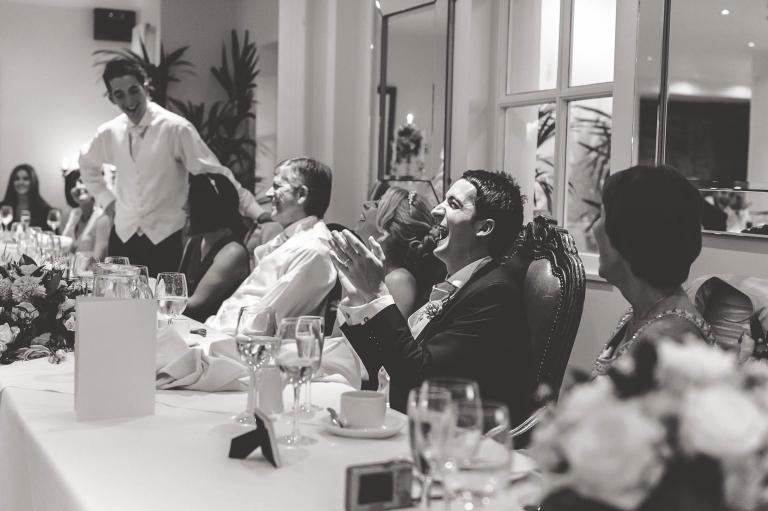 Groom laughs at best mans joke during speeches