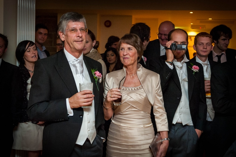 Brides mother and father watch the first dance