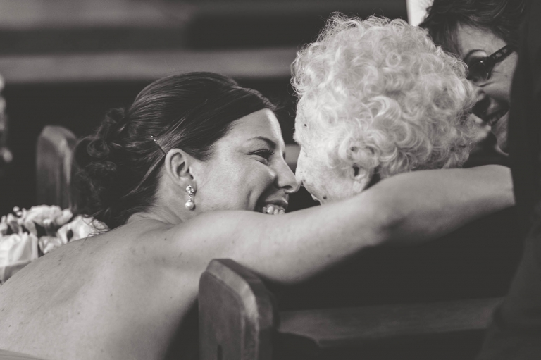 bridesmaid hugs grandmother