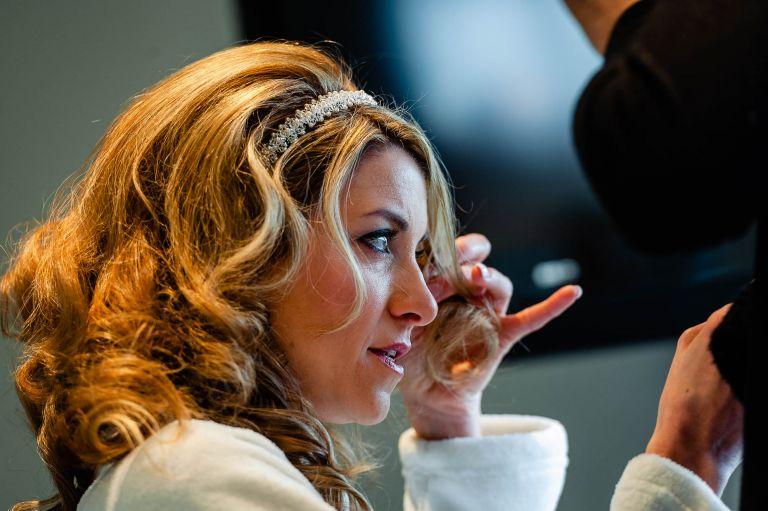 Bride adjusting her hair