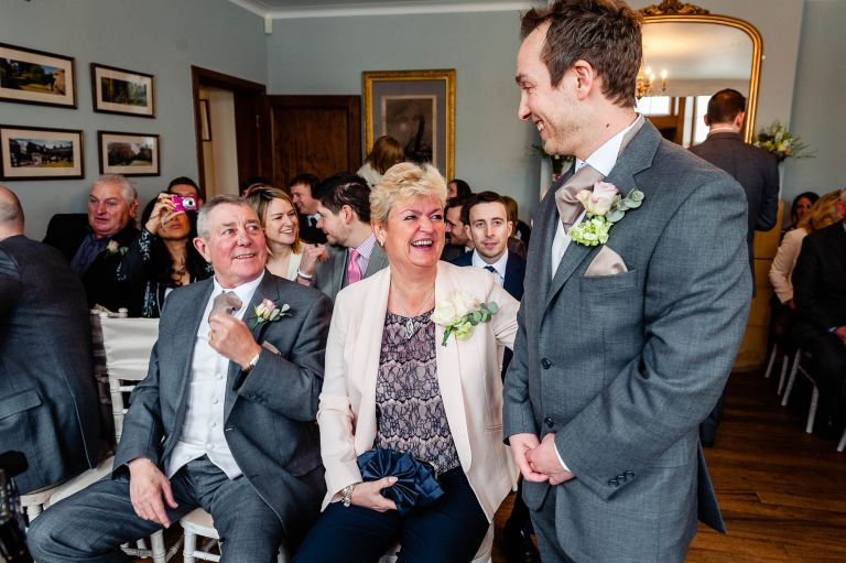 Groom share a joke with his father