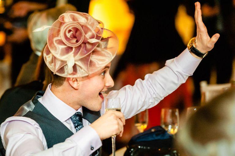 Male guest wearing woman's hat