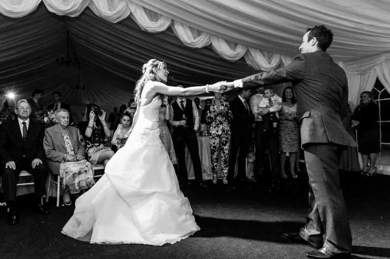Bride and groom dancing first dance