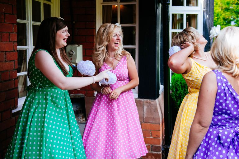 Bridesmaids larking about