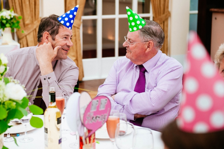 wedding guests with party hats