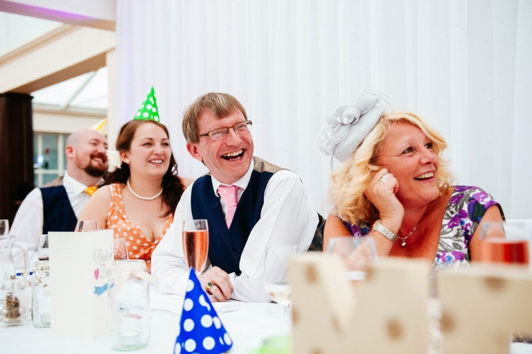 Father of the bride tells a joke during the speeches