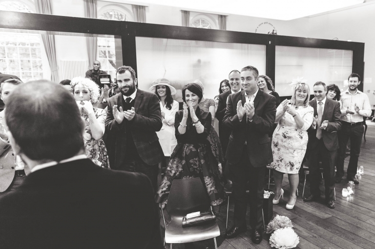 Guests cheer happy couple