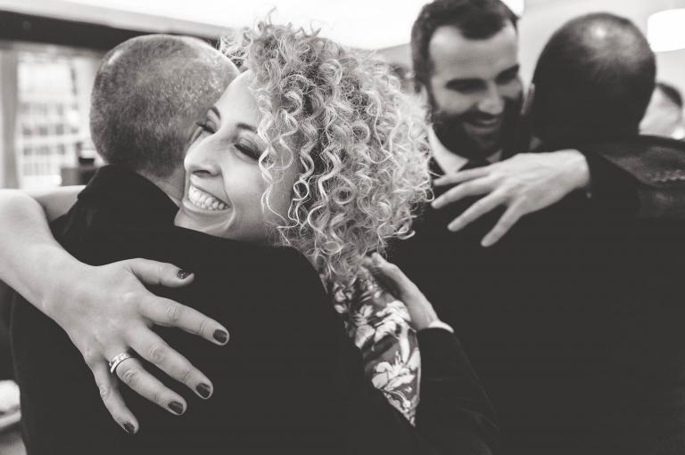 guest hugs partner