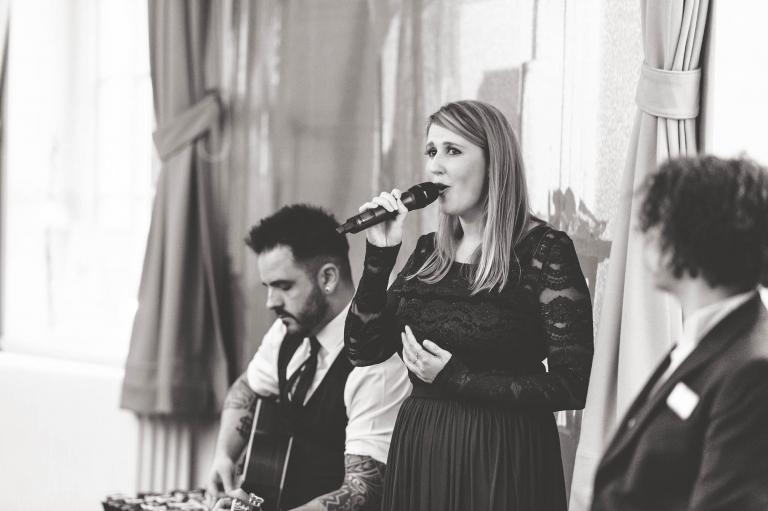 Guest sings as grooms enter the room
