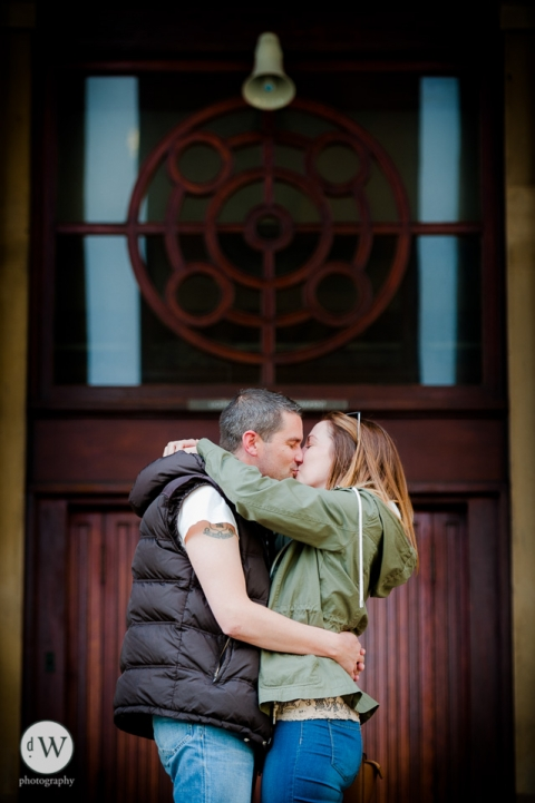 Couple kissing in front of a door