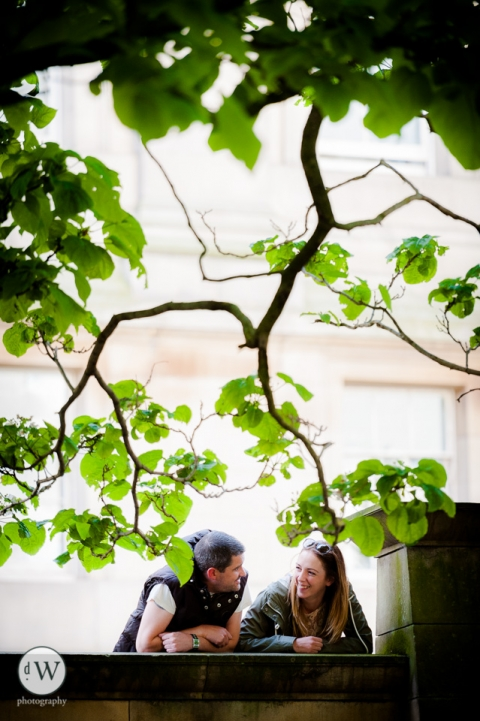 Couple leaning over wall