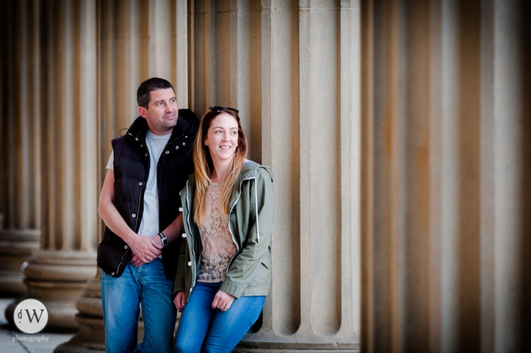 Couple leaning against St Georges hall pillars
