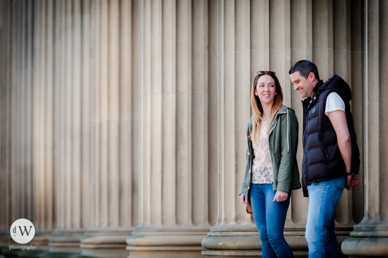 Couple smiling together in front of St Georges hall
