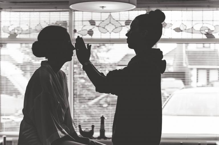 Bride having make up applied