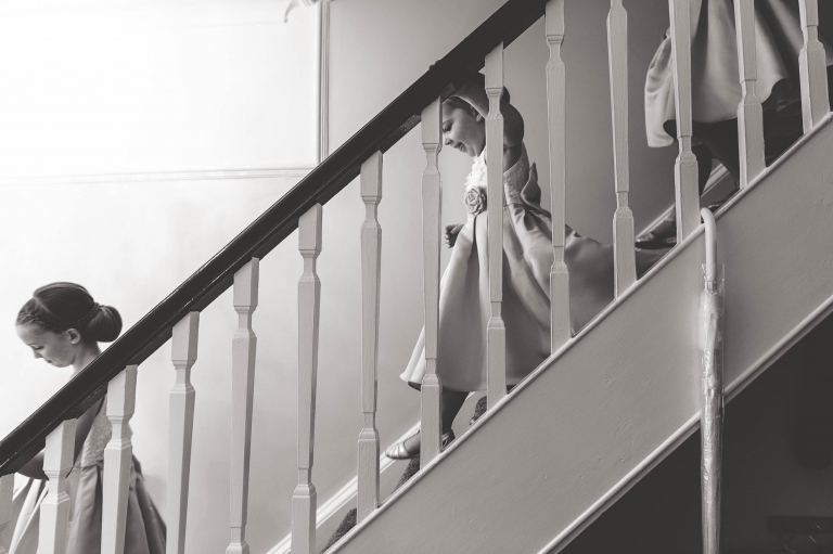 Flower girls walk down stairs
