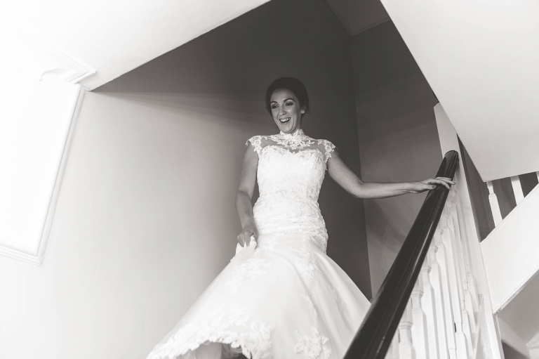 bride walks down the stairs in her dress