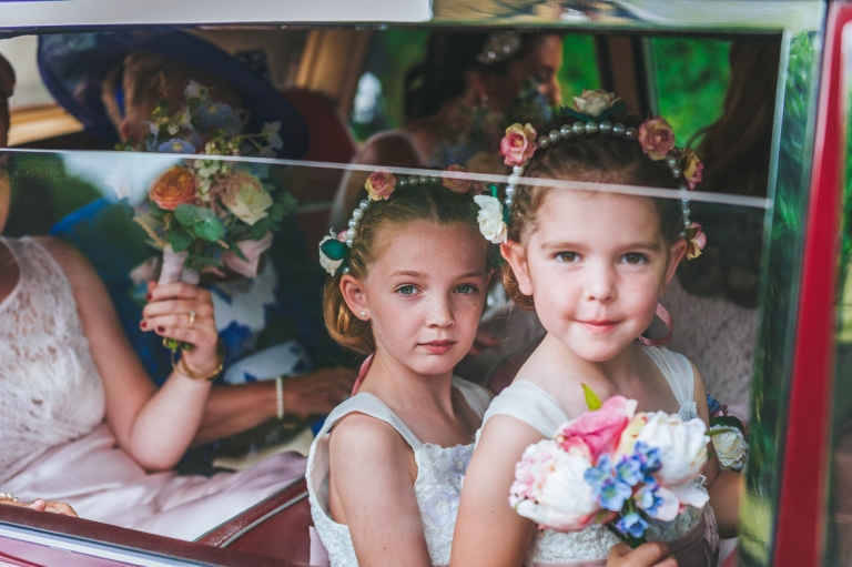 Bridesmaids and flower girls arrive at the church