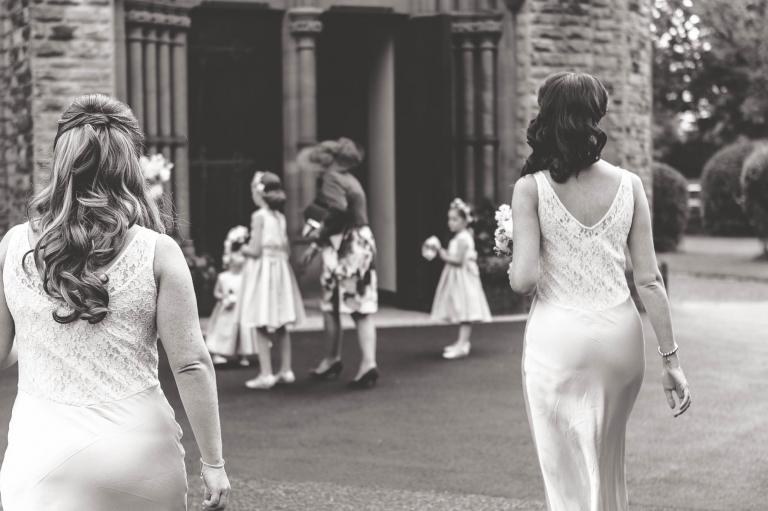 Bridesmaids walk to church