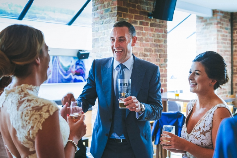guest shares a joke with bride