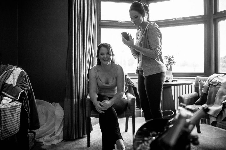Bride shares a joke during bridal preparations