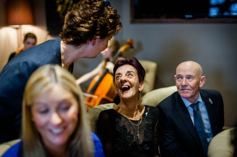 Guests sharing a joke in the ceremony room