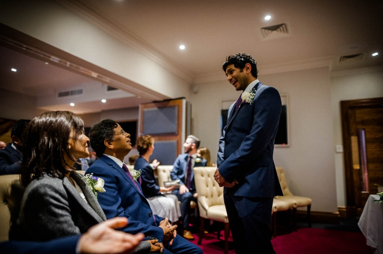 Groom shares a joke with his parents