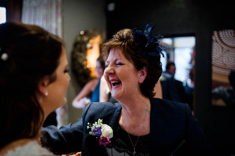 Brides mum congratulates the bride