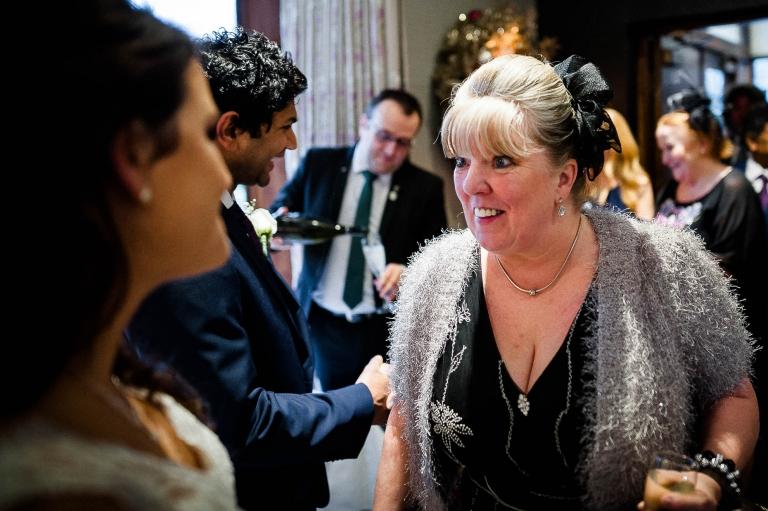 Weeding guest congratulates the bride
