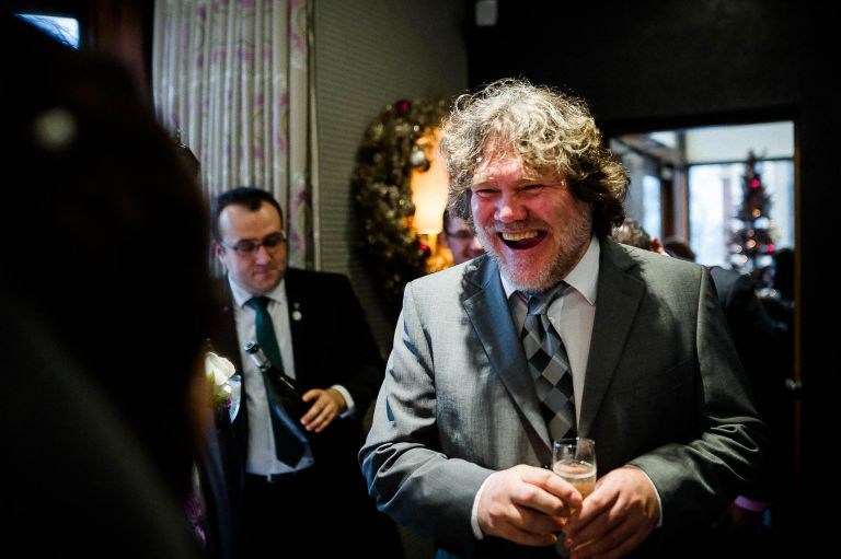 wedding guest shares a joke with the bride