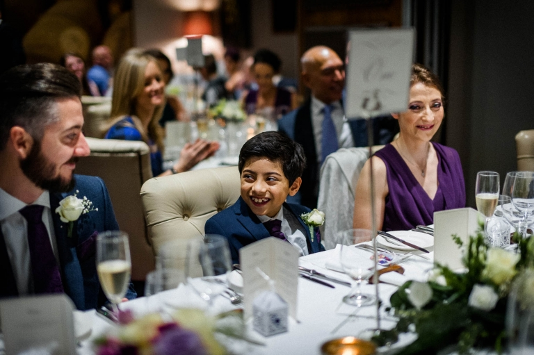 Little boy shares a joke with brides brother