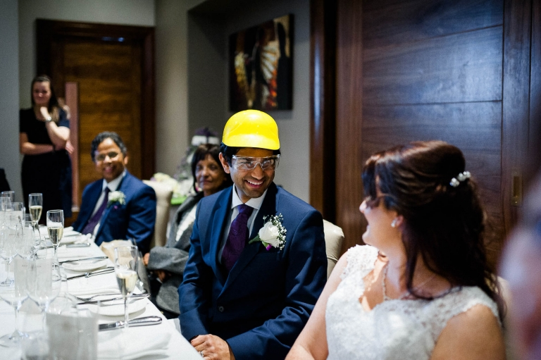 Groom wears a hard hat during speeches