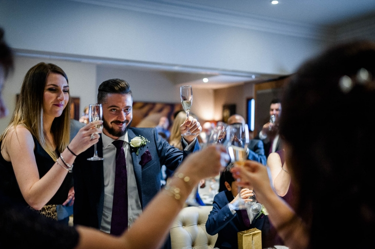 Wedding guests toast the happy couple