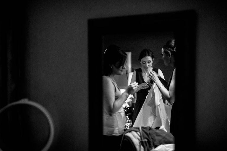 Bride and bridesmaids reflection in mirror