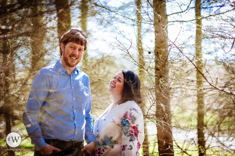 couple standing together in a forest