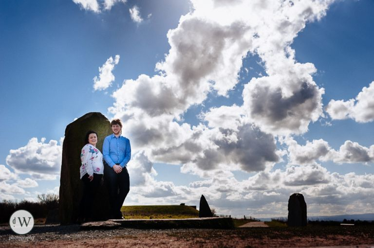 Couple leaning against a standing stone