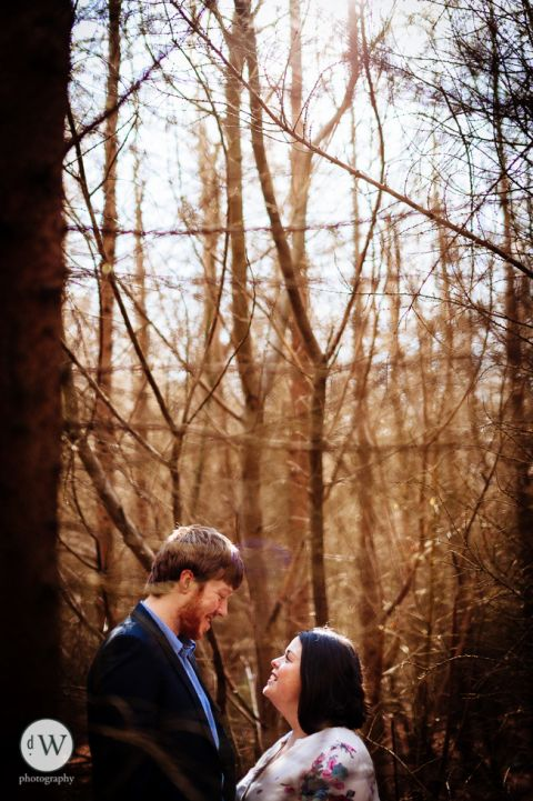 couple facing each other in the woods