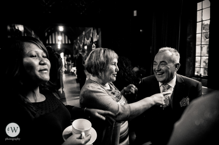 Mother of the groom and guest share a joke