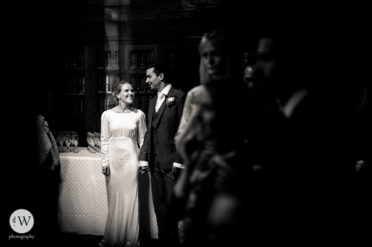 Bride and groom holding hands smiling