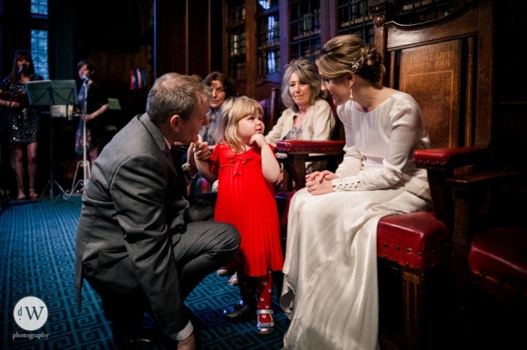 Little girl talking to the bride