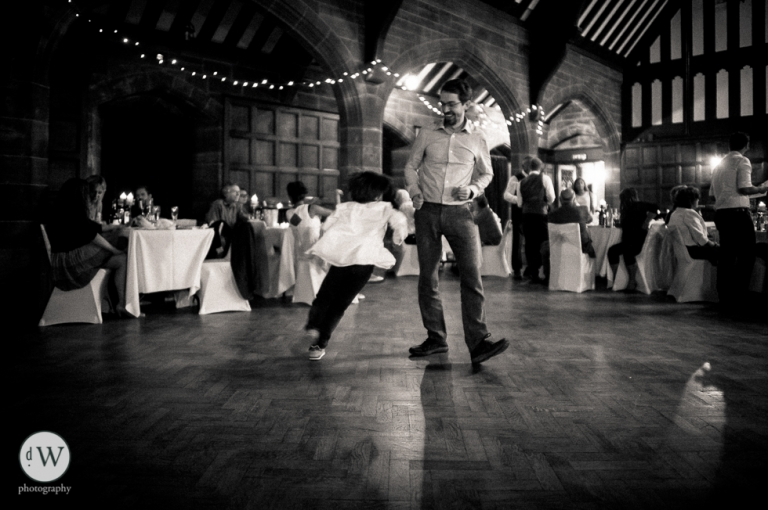Little boy dancing with father