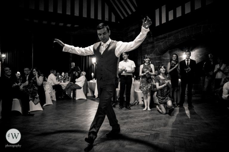 Groom greek dancing