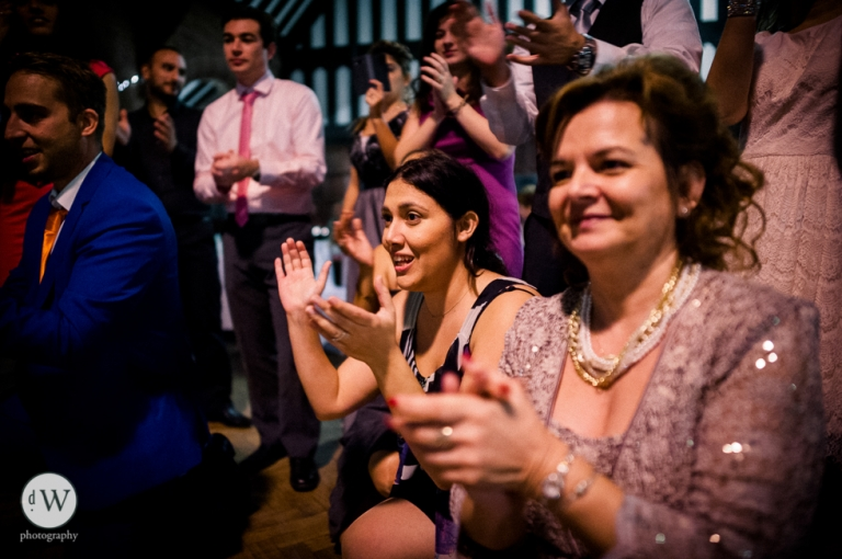 Mother of the groom watching her son dance