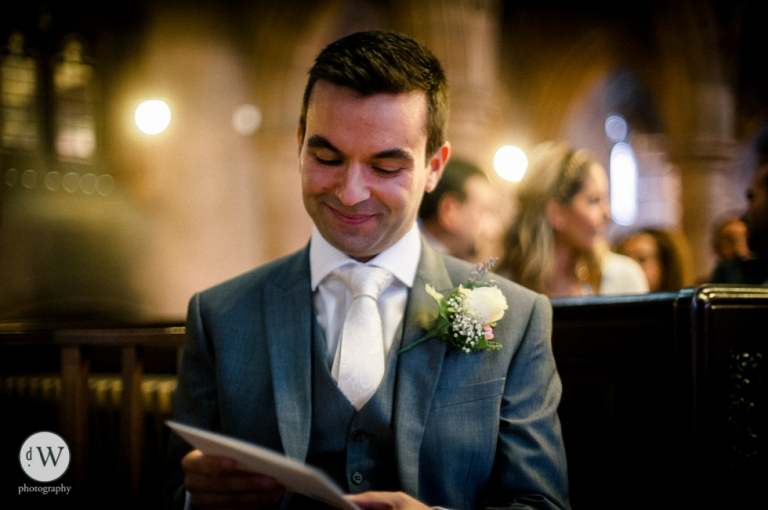 Groom reads a note from his bride