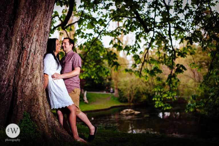 Couple lean against a tree